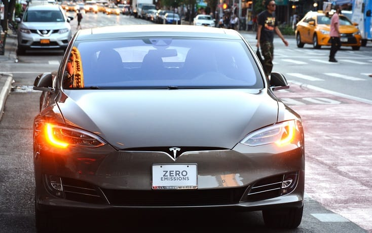 Tesla car with front license plate