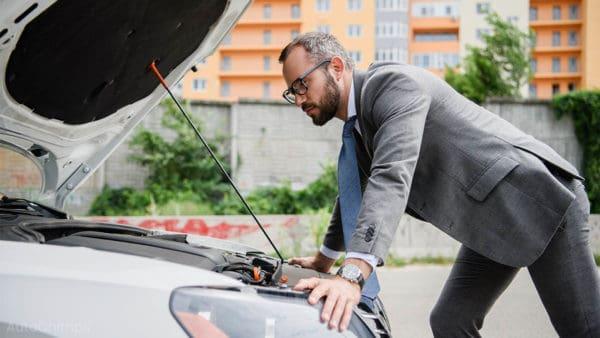opening the hood of a broken car