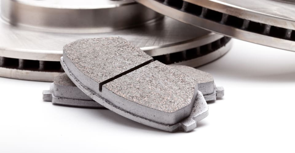 brake pads with brake disks in the background