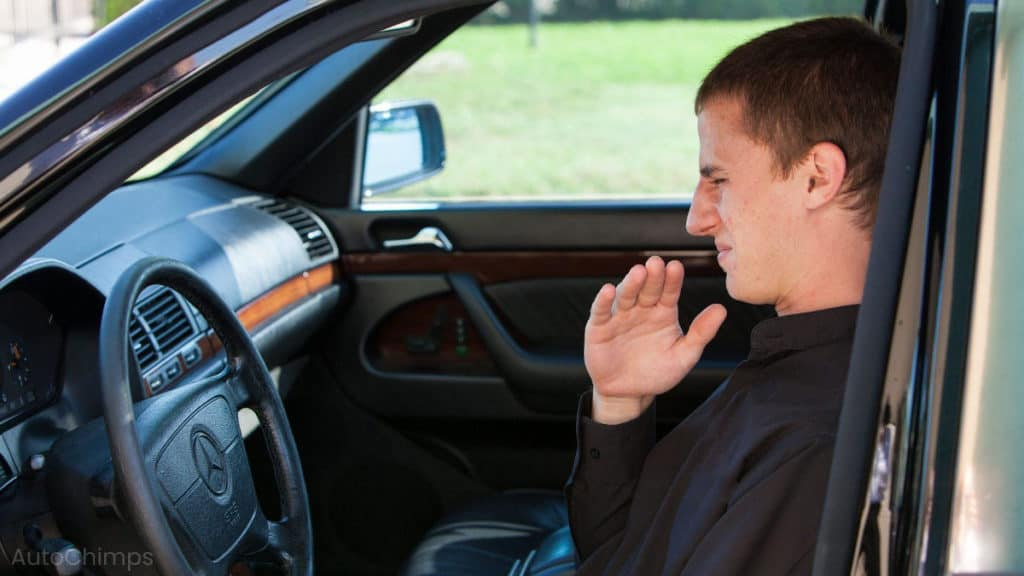 man and bad smell inside car