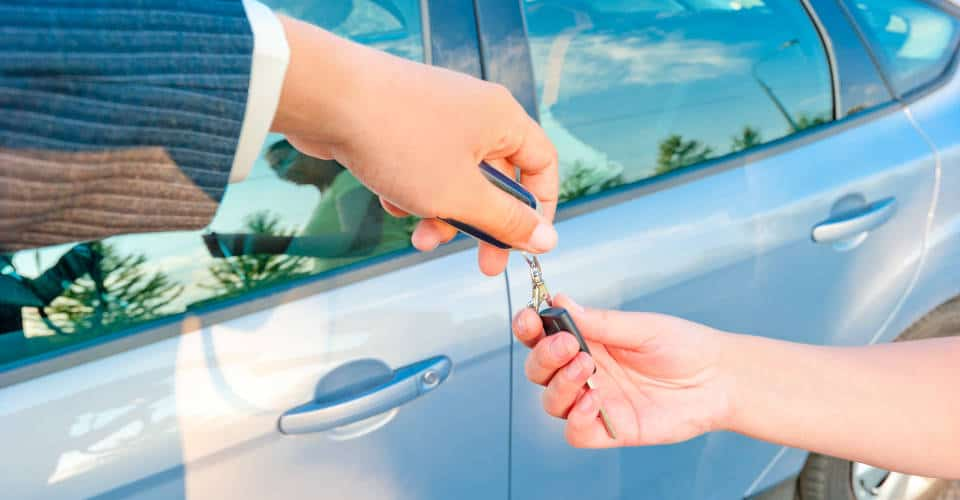 handing car key to new owner