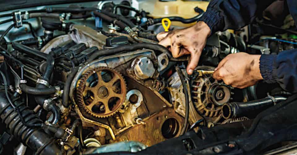 mechanic fixing or rebuilding engine