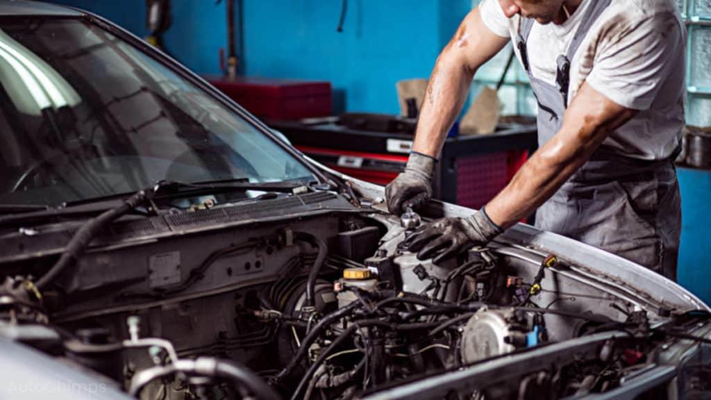 mechanic repairing or rebuilding engine