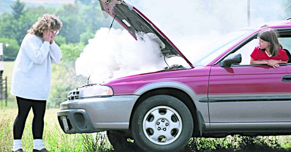 mother opens smoking car hood while daughter sits inside car