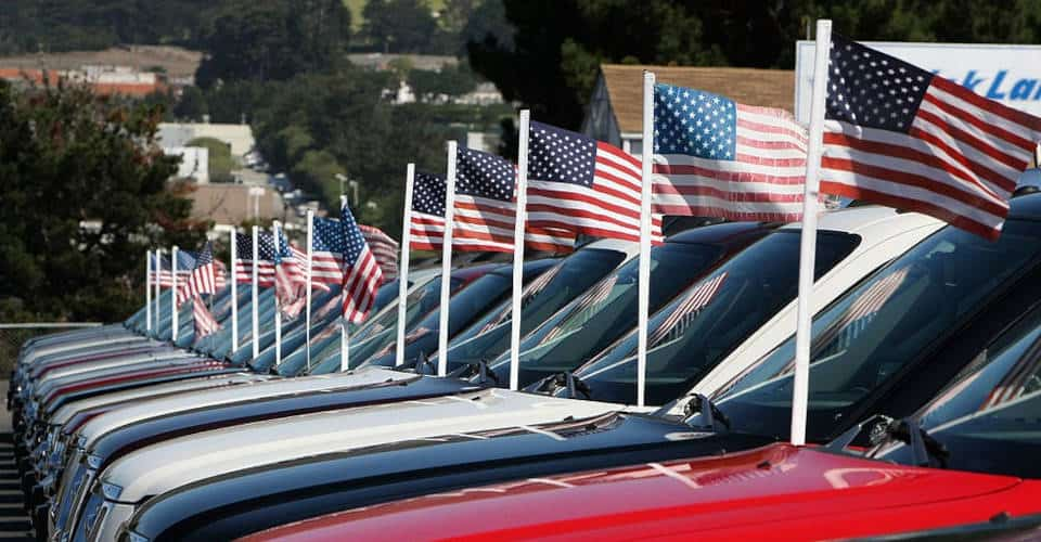 pickup trucks with attached American flags