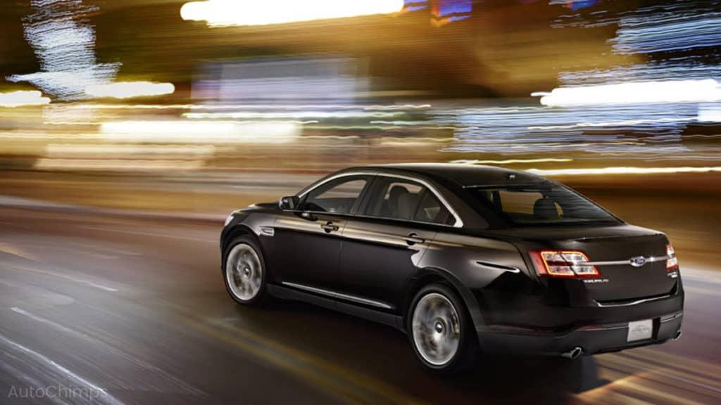 accelerating black car