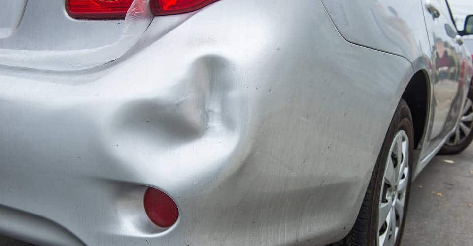car with dented back