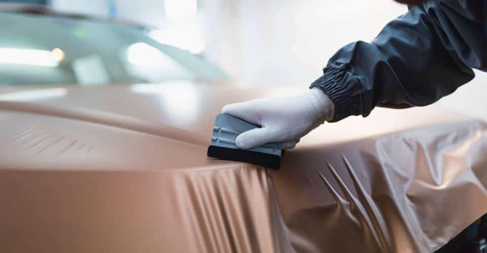 putting car wrap vinyl foil or film on car front or back