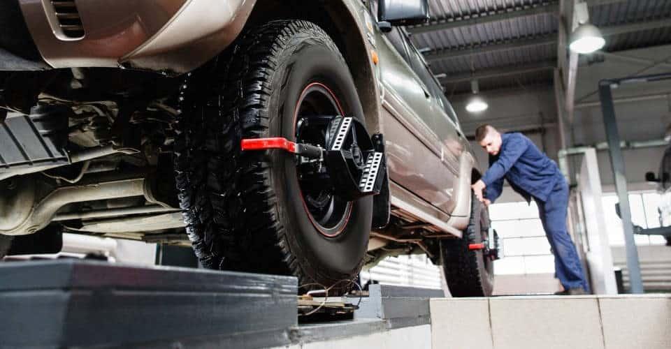 tire undergoing wheel alignment