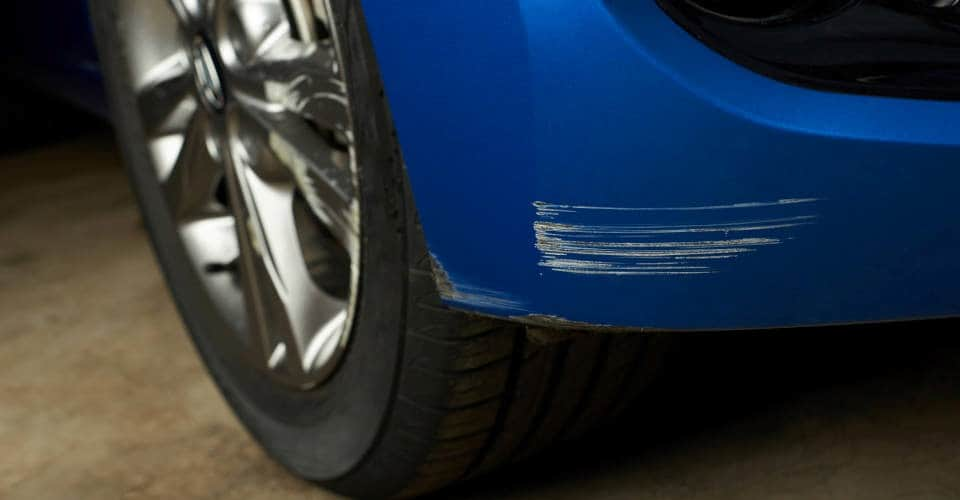scratches on blue car