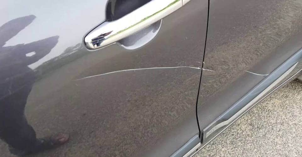 scratches on gray car