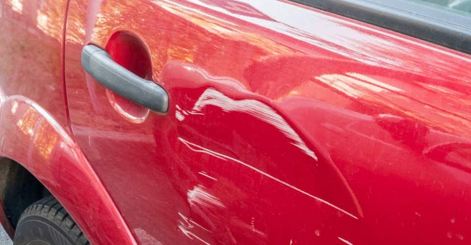 scratches on red car